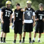 S0808FTBALL13.jpg University of Colorado quarterback Cody Hawkins (7), talks with fellow quarterbacks Jerry Slota (13), Clark Evans (4) and Tyler Hansen (9) at the first practice of the season at CU's practice field on Friday, Aug. 7, 2009.  Photo by Mara Auster/Daily Camera